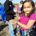 A handful of native prairie plant seeds and a smile