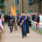 David Baker carries the Mace at Commencement 2016