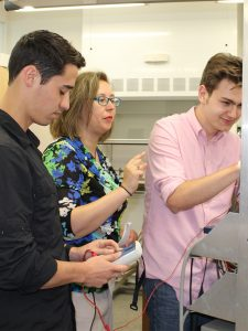 Andra Petrean with students in lab